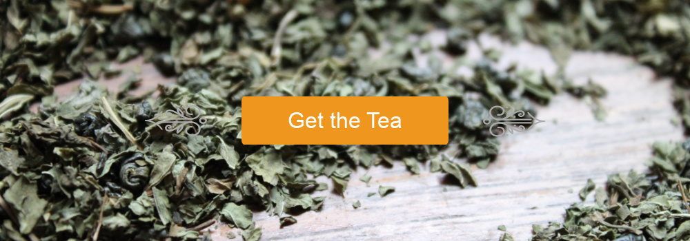 """""""Get the Tea"""" button with scroll embellishments upon a background of Moroccan Mint tea"""